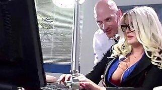 Busty office slut sucks a big sexstick