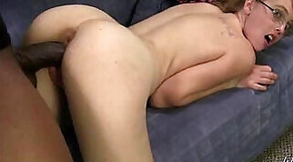milf that has large tits is getting a big black cock in her wet pussy