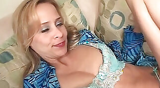 Blonde Cougar Giving Head To A Big Black Dick